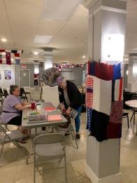 Brenda Oelbaum and Jane Reiter running the Art Table